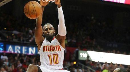 Tim Hardaway Jr. dunks over Washington Wizards'