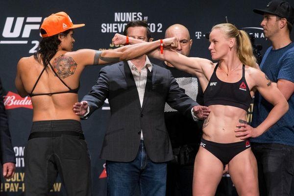 Amanda Nunes, left, and Valentina Shevchenko pose during