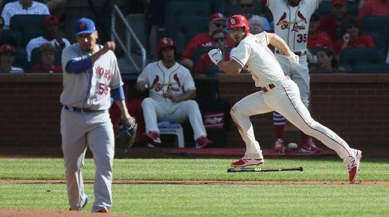 The Cardinals' Paul DeJong runs for a double