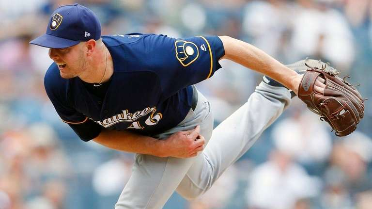 Corey Knebel of the Brewers pitches against the