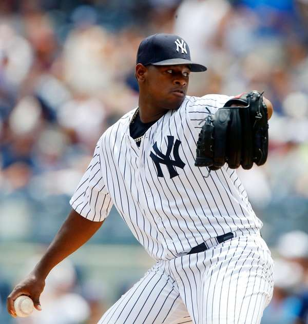 Luis Severino pitches in the first inning against