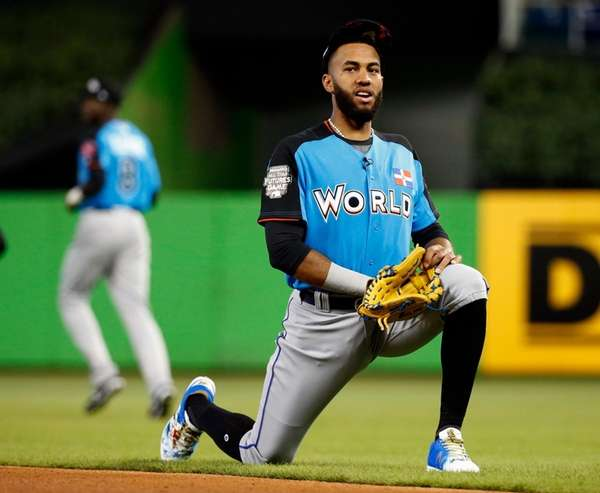 World Team shortstop Amed Rosario stretches-out before the