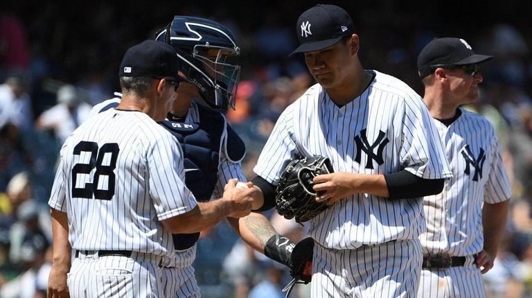 Yankees manager Joe Girardi takes the ball from