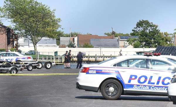 Police investigate after the body of an Amityville