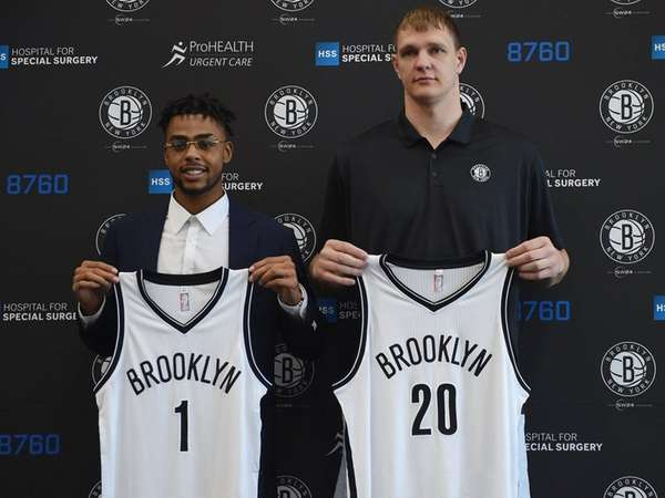 The Nets newest players D'Angelo Russell, left, and
