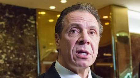 Gov. Andrew Cuomo speaks with reporters in the