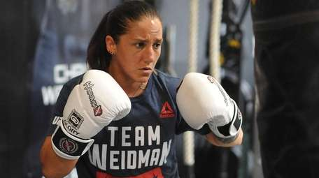 Female mixed martial arts fighter Jennie Nedell trains