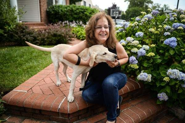 Julia Perl, of Syosset, with puppy Brody, at