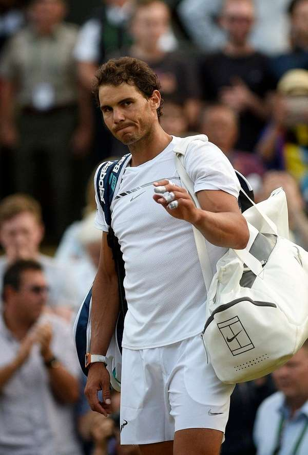 Rafael Nadal of Spain reacts after losing against