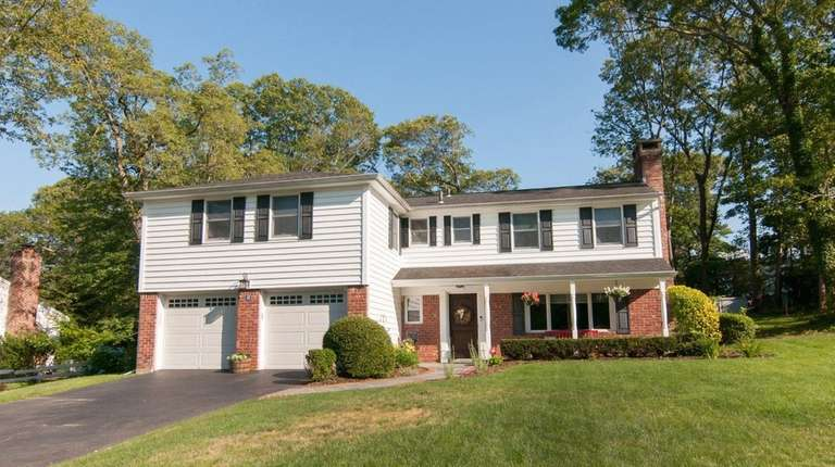 This Port Jefferson Colonial is listed for $689,000