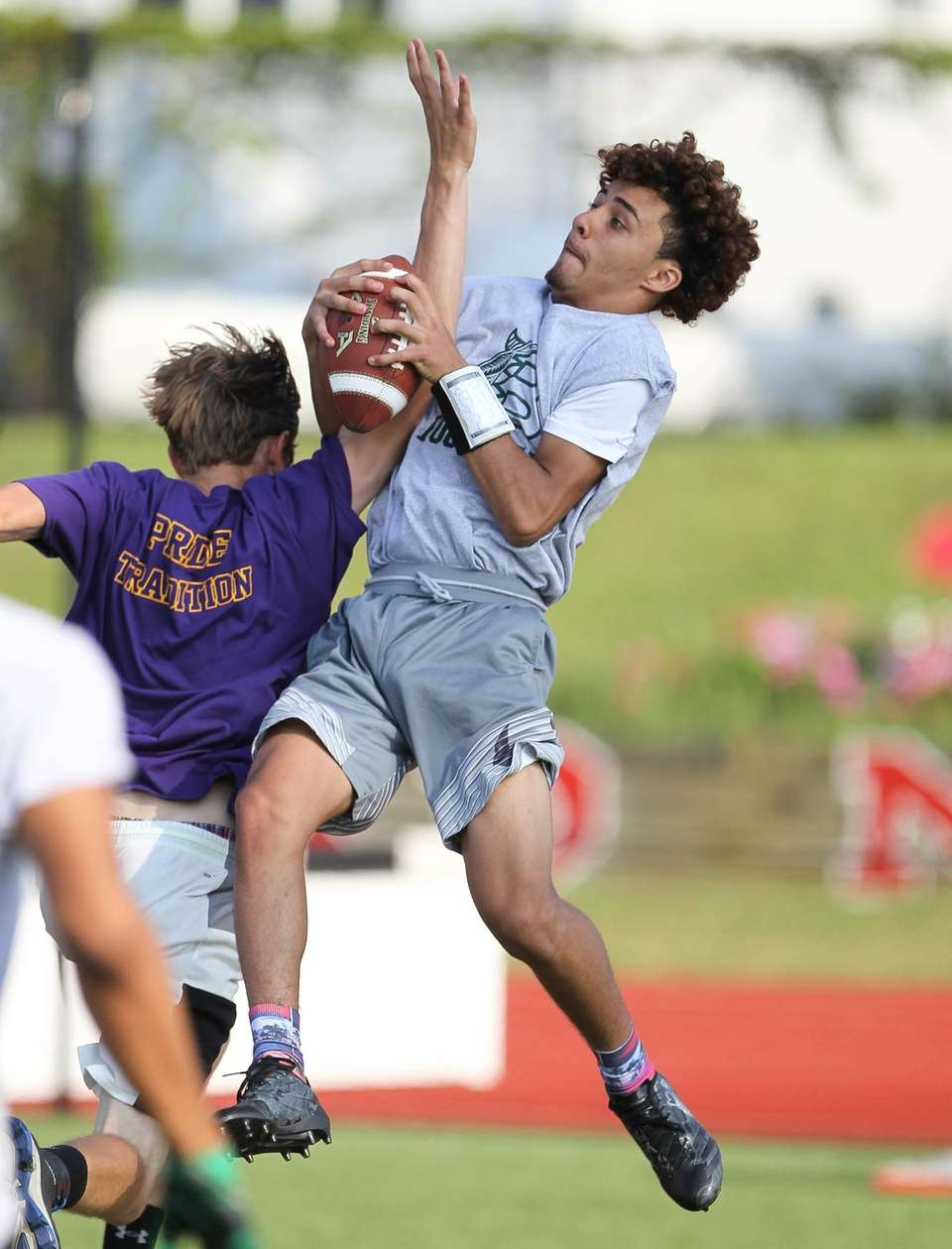 Brentwood's Kenny Lazo grabs a pass during the