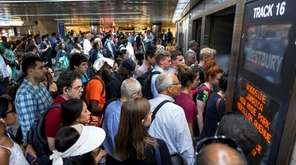 LIRR commuters push toward a train that has