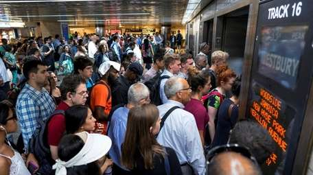 LIRR commuters push toward a train that has