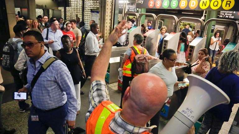 MTA personnel direct Long Island Rail Road commuters