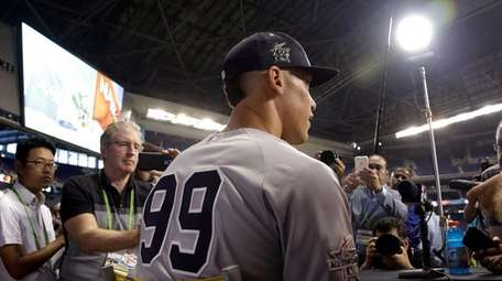 Yankees' Aaron Judge (99) talks before the All-Star