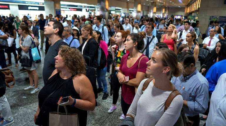 LIRR commuters wait to see track assignments for