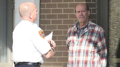 Jeffrey Bernstein, 74, of North Babylon, is escorted
