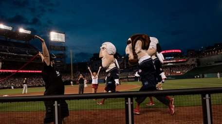 Mascots dressed as former presidents race during the