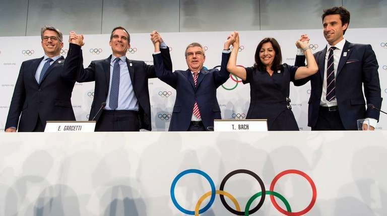 The International Olympic Committee members voted unanimously to