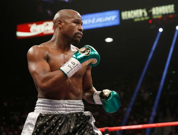 Floyd Mayweather Jr. fights Andre Berto (not shown)