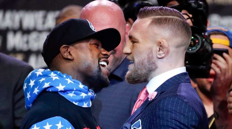 Boxer Floyd Mayweather Jr., left, and mixed martial