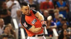 Giancarlo Stanton of the Miami Marlins competes