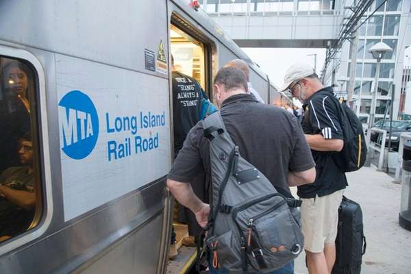 Commuters at the LIRR station in Mineola as