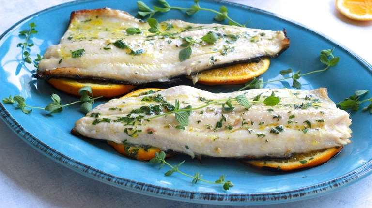 Trout fillets brushed with mustard-orange-herb mixture are grilled