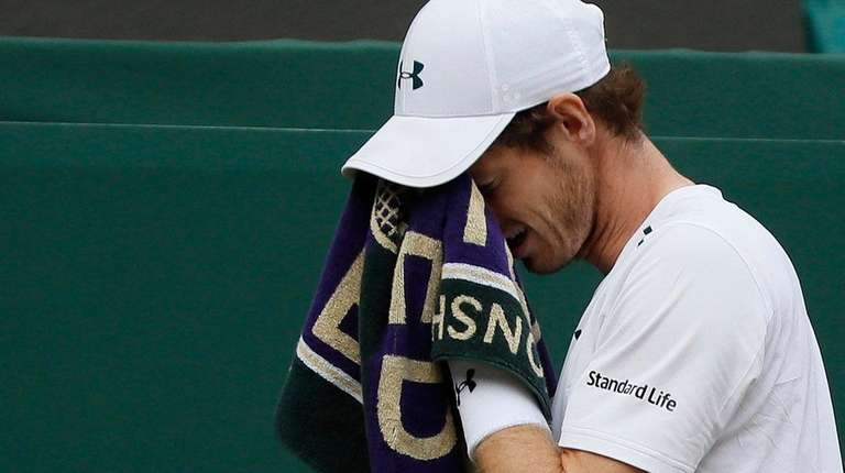 Andy Murray wipes his faceduring amen's singles quarterfinal