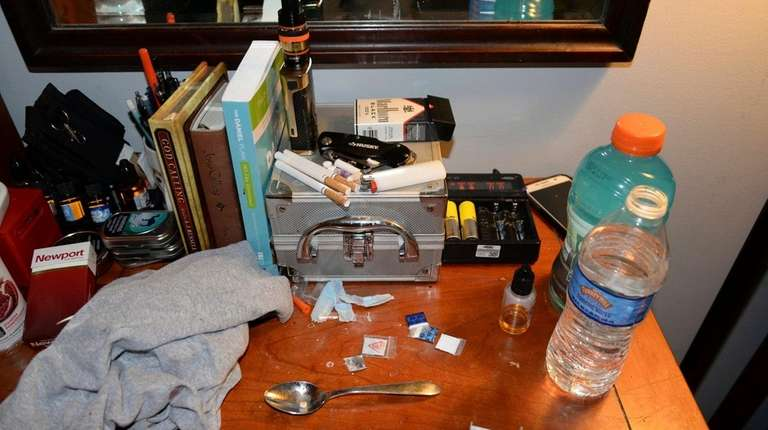 Opioid drug packets, a syringe and other belongings