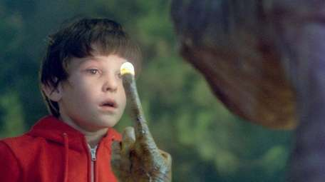 Elliott (Henry Thomas) and his alien buddy's famous