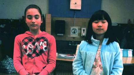 Kidsday reporters Gianna Montoni and Julianne Wang practice