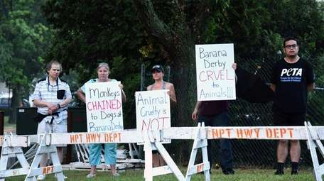 Local animal rights activists (from left) Warren Woodge