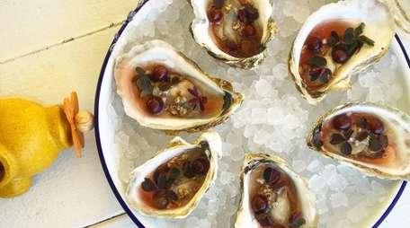 At EMP Summer House in East Hampton, oysters