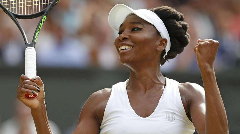 Venus Williams celebrates beating Johanna Konta in their women's singles