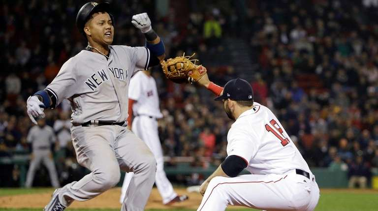New York Yankees' Starlin Castro runs to first
