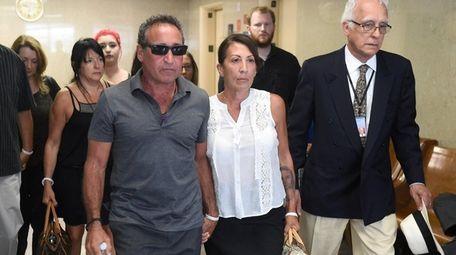 Philip and Cathy Vetrano, center, parents of slain