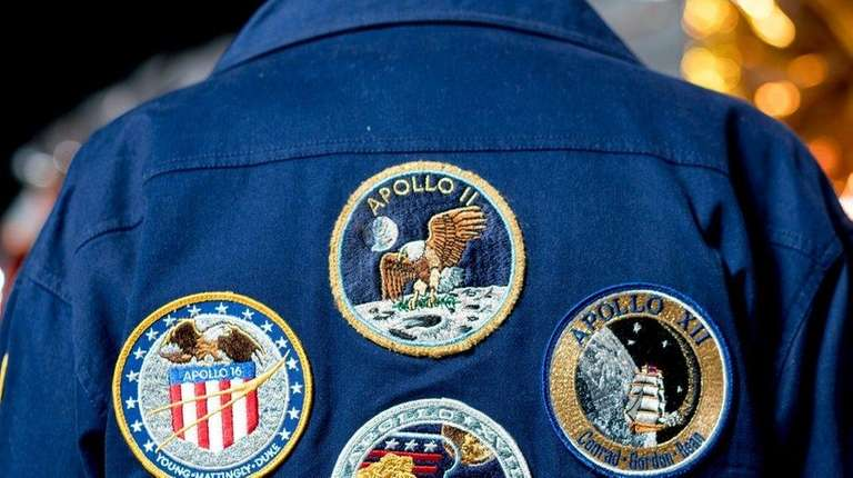 Ernest Finamore's jacket sports patches representing the lunar