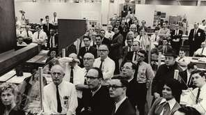 Engineers at Grumman's Plant 25 watch a live