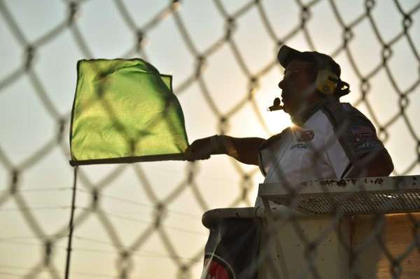 A flagman waves the green flag at Riverhead