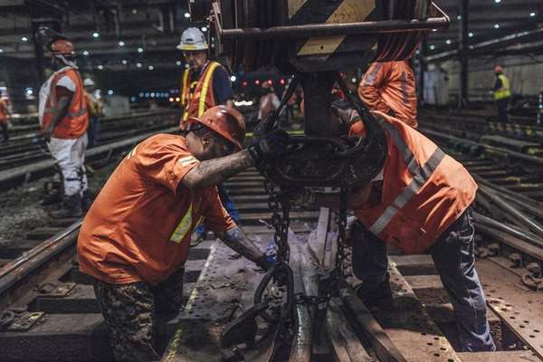 Amtrak crews lift old sections of track