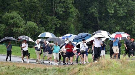 Fans endure the rain during the U.S. Women's