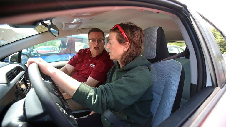Vehicle shopper Mary Jean Jones takes a test