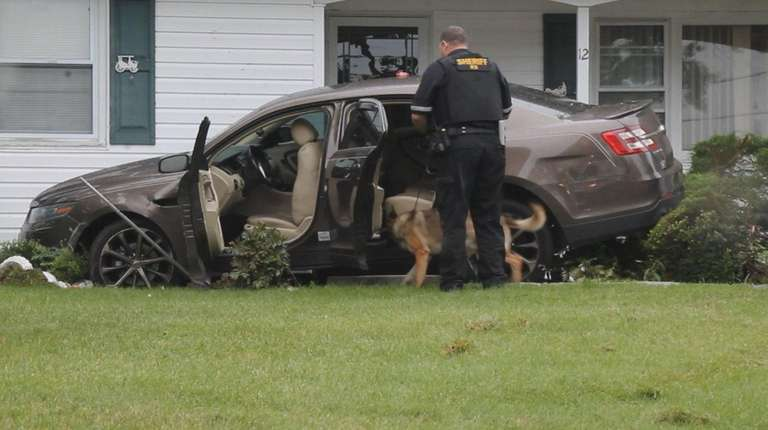 Three people in a Ford sedan fled from