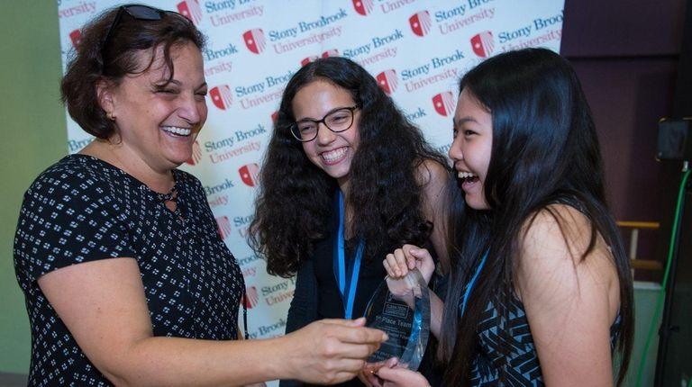 Alyssa Iryami, 15, center, and Audrey Shine, 16,
