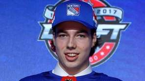 Filip Chytil poses for photos after being selected