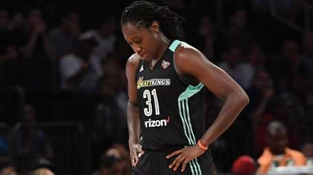 Liberty center Tina Charles walks to the sideline against