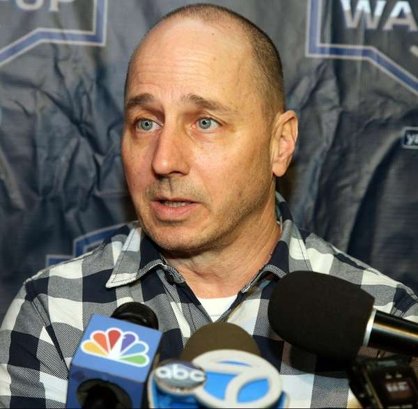 Yankees general manager Brian Cashman talks to media