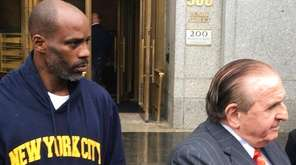 Rapper DMX, left, leaves federal court in New