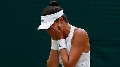 Spain's Garbine Muguruza celebrates as she beats Venus